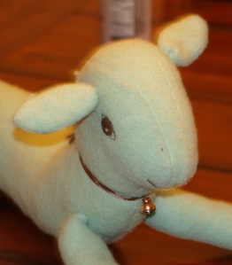 Lambie Pie's little bell is securely attached to a brown rayon ribbon, from Martha Stewart crafts.